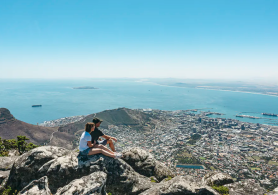 A couple taking in the view from Table Mountain, Cape Town.